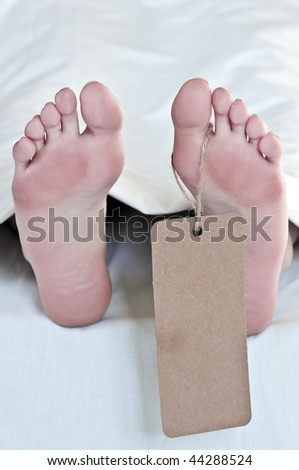 dead body legs with label