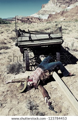 dead cowgirl lying on the floor, western style