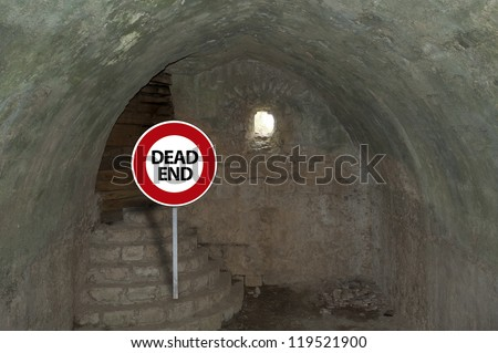 Dead end sign at the end of a crypt