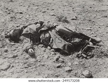 Dead German soldier in the Western desert after a British raid. Between major campaigns, North African WW2 fighting consisted of small and large raids on enemy positions. Ca. 1940-42. #249573208