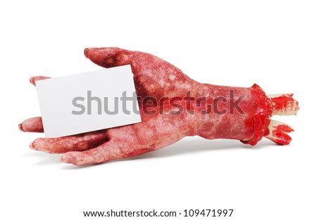 Dead Hand Holding Blank Business Card In A Halloween Horror Advertising Concept On White Background