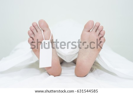 Dead man's foot on white background Foto stock ©