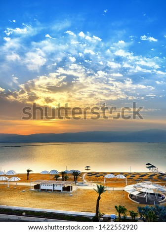 Dead Sea, is a salt lake bordering Jordan to the north, and Israel to the west. Its surface and shores are 430.5 metres 1,412 ft below sea level. Sunrise by the sea #1422552920
