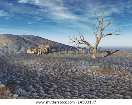 Dead tree on parched dry brown wasteland. Cracks in soil, boulder, and surreal blue sky.