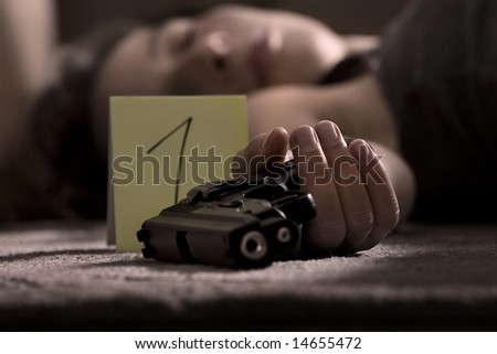 dead woman lying on the floor with gun in the hand