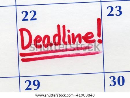 Deadline day written on a calendar. - stock photo