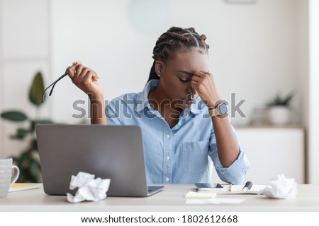 Deadline Stress. Overworked Black Female Entrepreneur Massaging Nosebridge At Workplace In Office, Exhausted After Using Laptop Photo stock ©