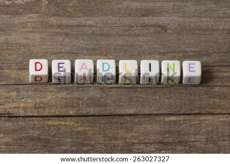 DEADLINE word on a wooden background