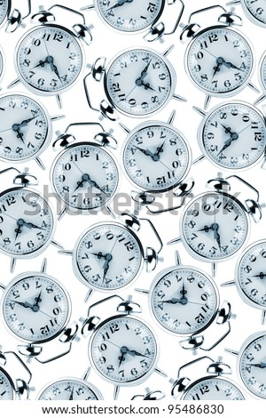 Deadlines and Time management concept - alarm clocks on the white
