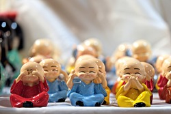 Deaf, dumb and blind toy monks, the three wise monks
