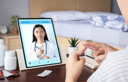 deaf mute patient use video conference, make online consultation by sign language with doctor on tablet application about illness, medicine via vdo call. Telehealth, Telemedicine, online hospital