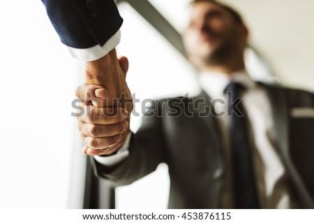 Deal Businessmen Handshake Partnership Concept #453876115
