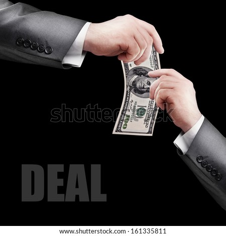 DEAL. Hand giving money to other hand. High resolution