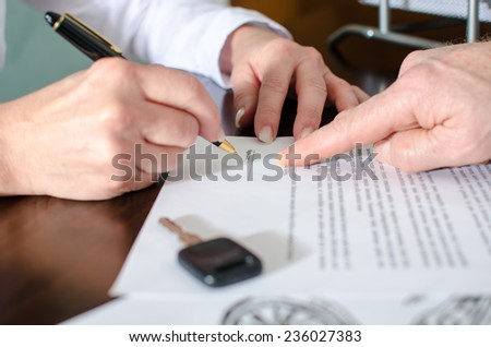 Dealer showing the signature place of a contract with his finger