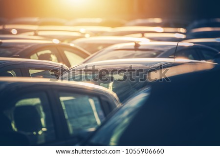 Dealership Lot Full of Cars. Automotive Sales Industry. Brand New and Pre Owned Vehicles For Sale.
