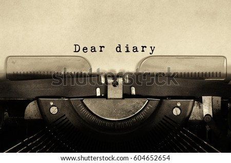 Dear diary words typed on vintage typewriter.
