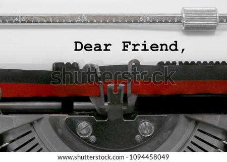 Dear friend text written by an old typewriter on white sheet #1094458049