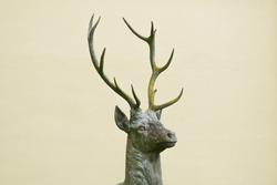 dear head face statue outside metal closeup decoration antlers sculpture