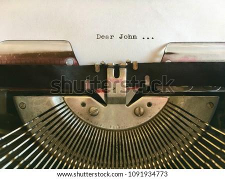 Dear John; text typed on white paper in vintage manual typewriter. Dear John letter #1091934773