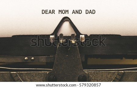 Dear Mom and Dad, Text on paper in Vintage type writer machine from 1920s closeup with paper #579320857