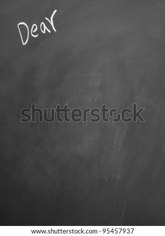 dear title written with chalk on blackboard