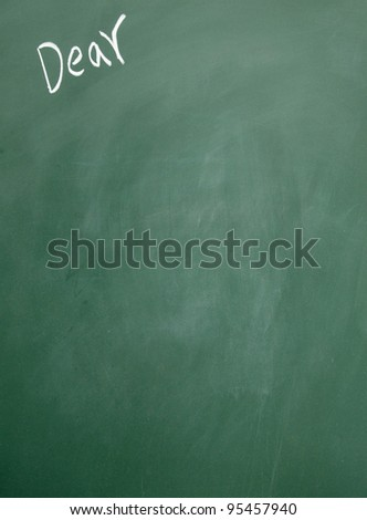 dear title written with chalk on blackboard