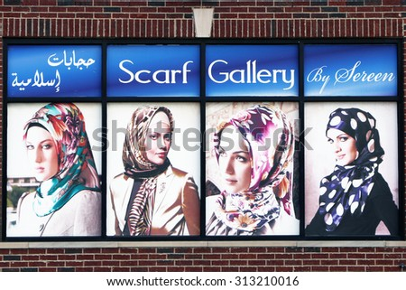 DEARBORN, MI-AUGUST, 2015:  Display window advertising head scarfs in a predominately Arab community near Detroit. Note that the advertising is in arabic script.