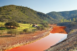Death and desolation in the Tinto River, Huelva, Spain. As a possible result of the mining, Rio Tinto is notable for being very acidic and its deep reddish hue is due to iron dissolved in the water.