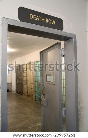death row sign and a cell block at a prison