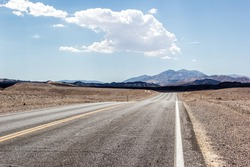 Death Valley, California. Lonely highway through the desert