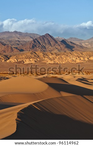 Death Valley. Image of rocky desert in Death Valley National Park with Mesquite Sand Dunes in the foreground.