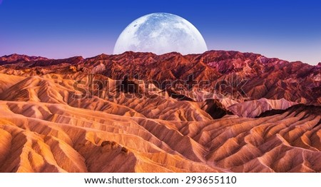 Death Valley Scenic Night. Death Valley National Park Badlands Sandstones Landscape and the Moon. California, United States.