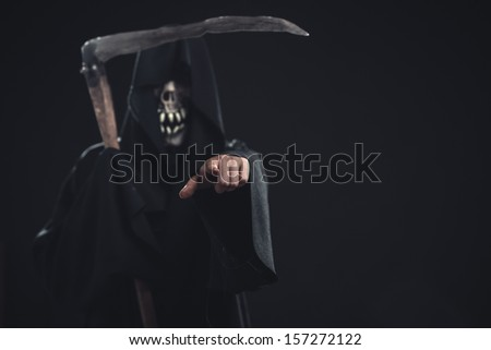 death with scythe standing  at night and points to you