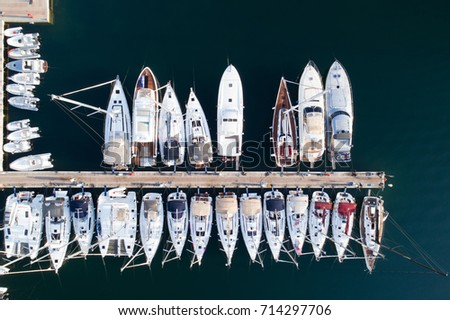 Deatil of pier with boats and yachts in Portisco marina, Sardinia, Italy #714297706