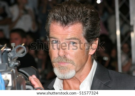 DEAUVILLE, FRANCE - SEPTEMBER 02: Pierce Brosnan arrives at the opening gala night of the 31st Deauville Film Festival where the movie 'The Matador'  on September 2, 2005 in Deauville, France