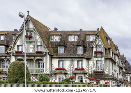 DEAUVILLE - JULY 18: Fragments of Anglo-Norman design of Normandy Barriere hotel on July 18, 2012, Deauville, France. 5 star hotel has English country-house design with dovecotes, turrets and gables.