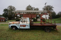 Debadged old truck with unsualy crane ladder hybrid hand crank sign lift.
