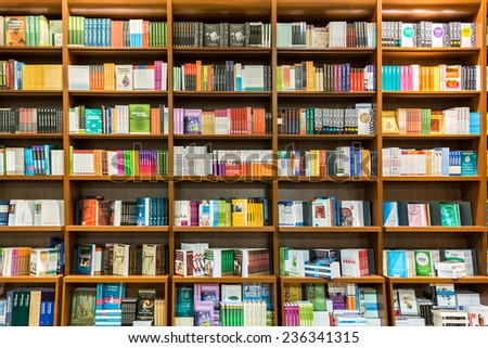 DEBRECEN, HUNGARY - AUGUST 24, 2014: Bookshelf In Library With Many International Books For Sale.