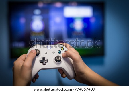 Stock Photo Debrecen, Hungary, 19. November 2017 View from the top on xbox one s gamepad, game console, kid holding in his hands
