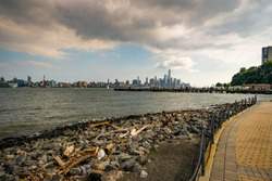 Debris and litter on the coast of NJ with New York City skyline in the background
