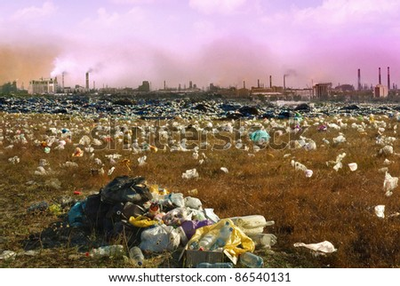 Debris dump and the mountain of garbage - ecology concept about mud and human activity. Environmental pollution from industrial  smoking and chimneys factories. Industrial destruction from the city.