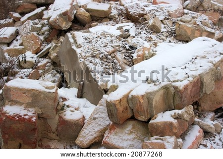 Debris of a destroyed building under the snow