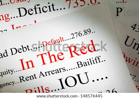 Debt Concept - In the Red - a conceptual look at being in debt.