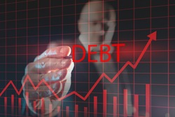 Debt growth graph on a virtual screen. Financier draws a rating for debt obligations. Concept -  growth of public debt. Ìan with a stylus in background. Economy. Financial market. Credit liabilities