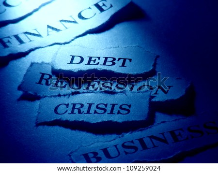 Debt, Recession, Crisis. Word written on a ripped piece of paper