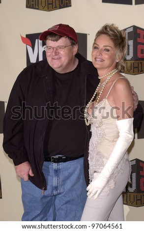 Dec 1, 2004; Los Angeles, CA: Actress SHARON STONE with documentary filmmaker MICHAEL MOORE at the VH1 Big in '04 Awards at the Shrine Auditorium, Los Angeles.  He won the Big Boat Rocker award.