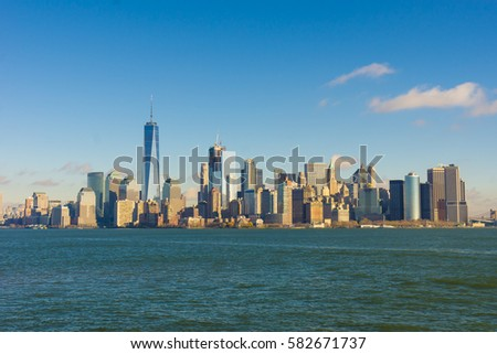 Dec 6, 2016: One world trade center cityscape with Hudson river, New York city, USA #582671737