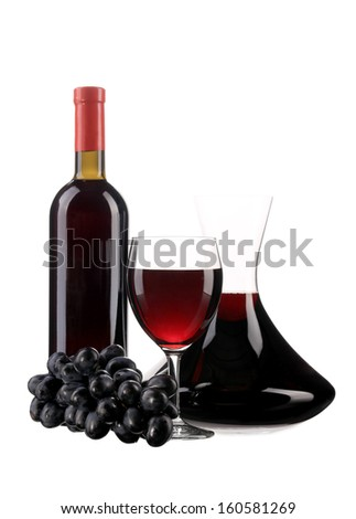Decanter botle and glass with red wine and ripe grape