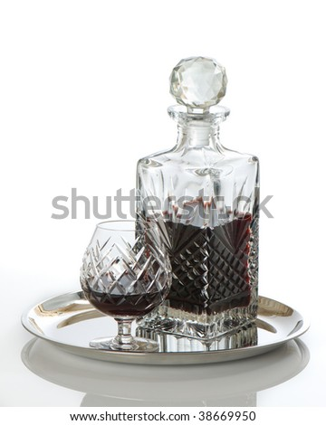 Decanter of rum with glass on silver serving tray - white background