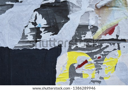 decayed old street ad poster shreds, torn ripped paper, use as abstract street art style texture
